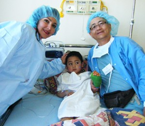 Dr. Fang with a patient and his mother after extensive hand surgery during a medical mission to Bolivia in 2011