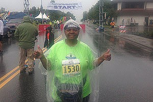 Frances Garrett gives a thumbs up sign at the Mayor's Half Marathon in Anchorage, Alaska last June.