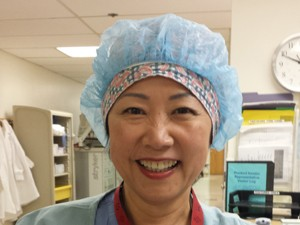Jungon Ahn, RN, who both works and volunteers in KP South San Francisco's operating room.