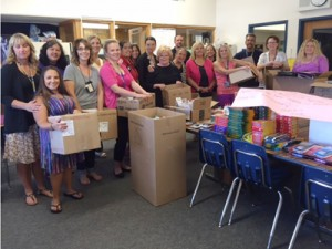 Kaiser Permanente Roseville employees pose with donations for a local school.